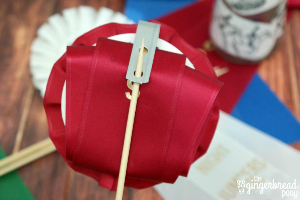 red ribbon on stick